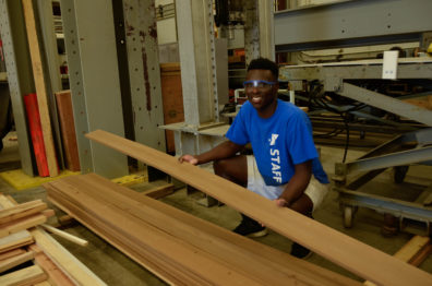 student working with lumber