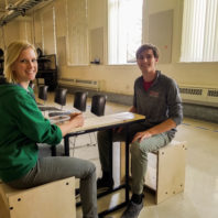 Annalise and Garrett sitting in the chairs they made.
