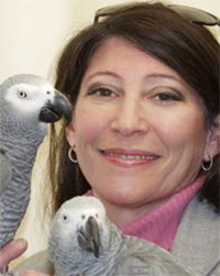 Irene Pepperberg with a pair of grey parrots.