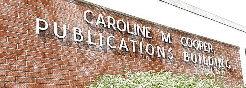 Cooper Publications Building brick facade and sign