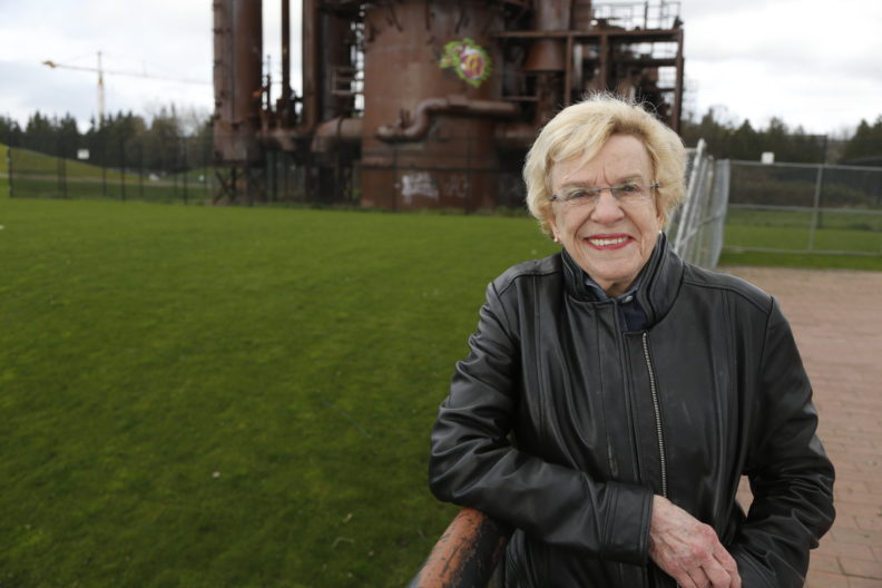 Jean Godden standing in front of a structure