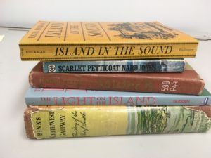 Stack of old books including Scarlet Petticoat by Nard Jones, Island in the Sound by Hazel Heckman, Mister B. by Irving Petite, The Light on the Island by Helene Glidden, and Northwest Gateway buy Archie Binns