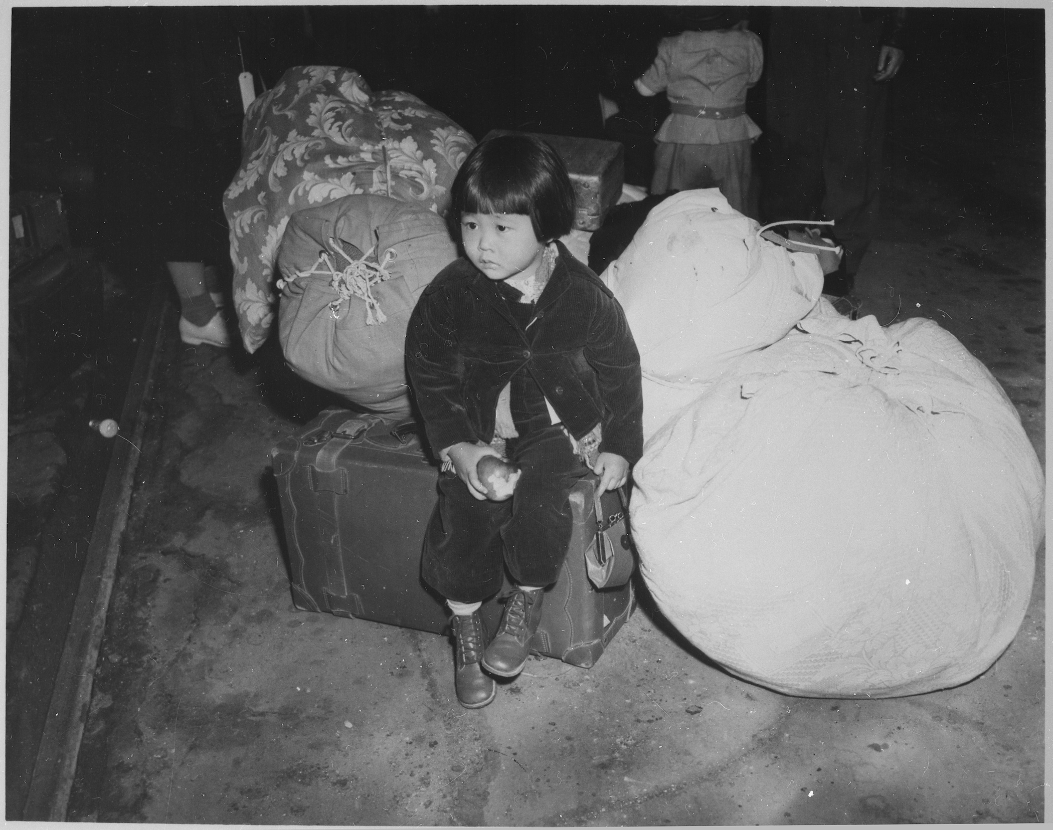 photo of Japanese American girl waiting with baggage