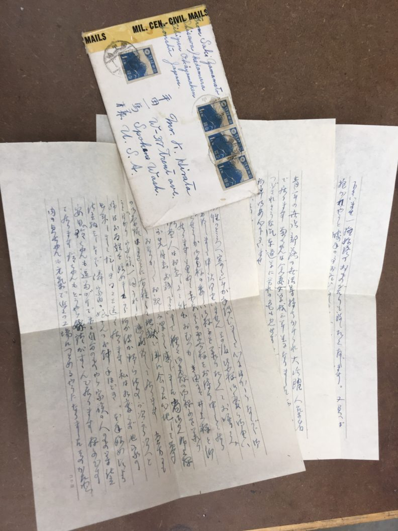 photo of envelope with censorship tape and hree page letter handwritten in Japanese
