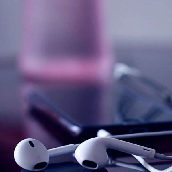 Photo of earphones laying on a desk