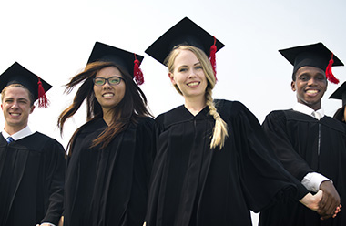 Graduating students in cap and gown.