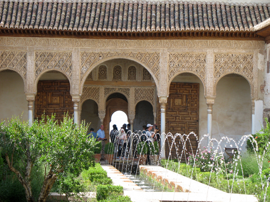 Welcome to Spain: Showing detailed ornamentation of the arches at one end of this famed patio.