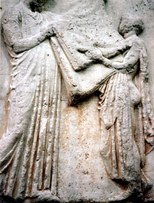 ELGIN MARBLES: Better to keep them at home, folding the laundry. Just kidding--this scene depicts the folding of the ritual garment annually carried to clothe the statue of Athena in the Parthenon.