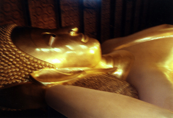 In one temple lay this gigantic golden Buddha. Worshippers constantly dropped tiny coins into a series of buckets behind the statue, creating a constant, shimmering, metallic sound. I thought at first it was birds chirping.