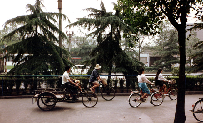 "CHENG DU: Goods were also hauled by bike. Note the empty ""truck"" at left."