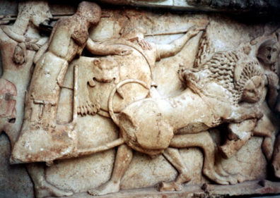 DELPHI: Lion attacking a hoplite (foot soldier), from the Gigantomachy (battle against the Titans) originally part of the north frieze of the Treasury of the Siphnians.