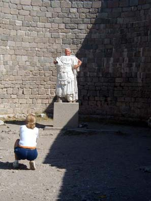 PERGAMUM ACEOPOLIS: Tourist posing behind a replica of the statue of Trajan found on the site.