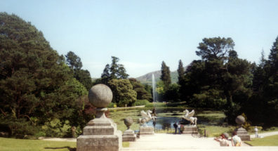 """POWERSCOURT: The formal garden is anchored by this spectacular pond. In the center is a replica of Bernini's Triton fountain from the Piazza Barberini in Rome (mistakenly referred to by many people as the """"Zeus Fountain at Powerscourt""""), and there is a winged Pegasus on each side of the path."""