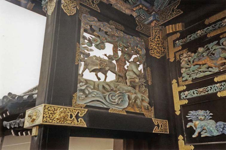 KYOTO: A few details of the ornate carving on the gate. May 24, 1998