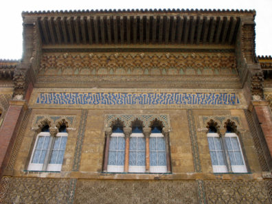"""SEVILLA: The highly stylized Kufic calligraphy in blue and white reads """"There is no conqueror but Allah."""" It is surrounded with a Spanish inscription praising the builder of the main part of the Alczar, the Christian Pedro I."""