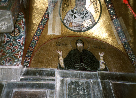 OSSIOS LOUKOS: Saint Loukos himself, after whom the church is named. The patches on the mosaics reflect repairs undertaken after a damaging earthquake.