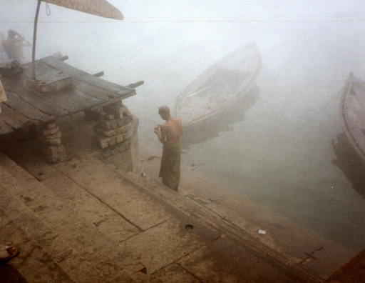 These ghats (riverside steps) are usually crowded with worshipers seeking to bathe in the sacred waters of the Ganges; but on this foggy winter morning there were few.