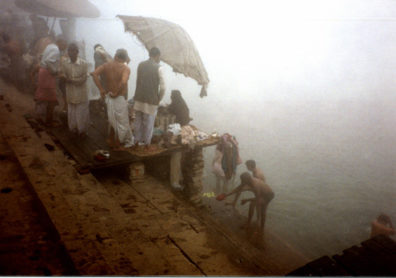 Worshipers bathing in the holy Ganges on a foggy winter morning.