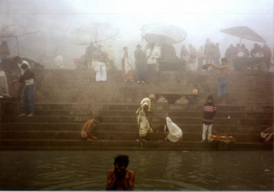 We saw some more bathers as our boat made its way along the ghats in a mist so thick we couldn't make out the tops of the buildings on shore. A water-borne huckster clung to our boat and tried to sell us souvenirs.