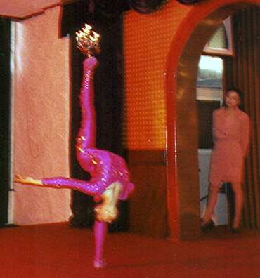 SHANXI: This was followed by traditional Chinese acrobatics. Here a contortionist balances flaming lamps on her feet. Eventually she held five of them.