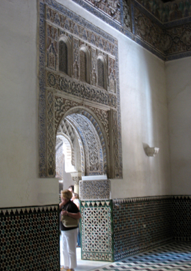 SEVILLA: Arched doorway leading to an enclosed patio.