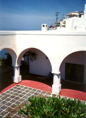 SANTORINI: We learned that we had been bumped from our hotel to the luxurious Santorini Palace Hotel, built in the style of the island's traditional architecture