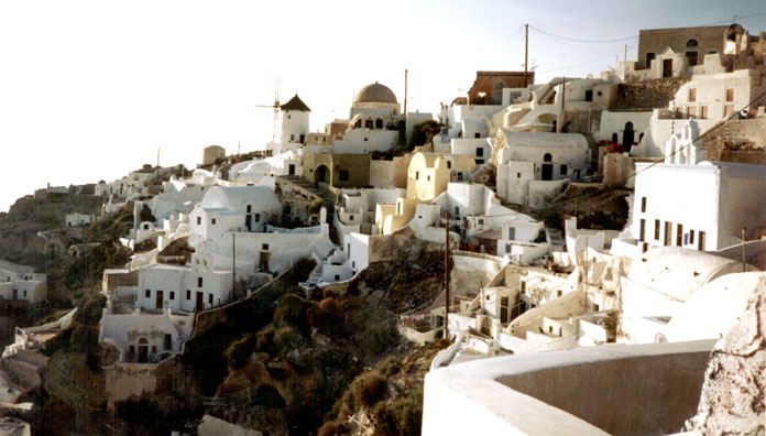 SANTORINI: At the northern tip of the island, the old city of Oia curves in a crescent of whitewashed houses.