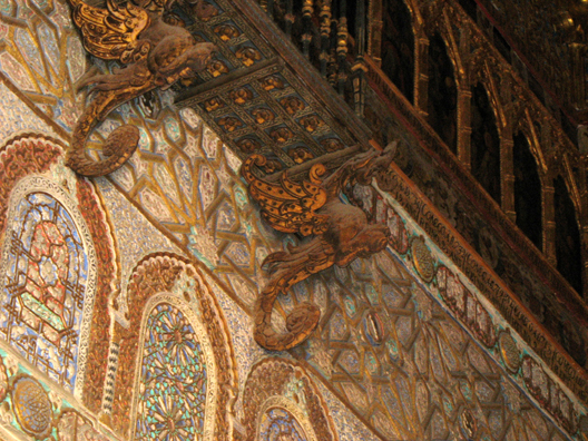 SEVILLA: The brackets supporting the balcony are winged dragons.