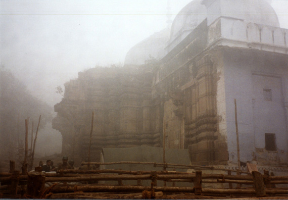 It was too misty to get a clear shot of the Golden Temple of Shiva. It lies immediately adjacent to this mosque, built on the ruins (and actually incorporating parts of) an earlier Hindu temple, and which Hindu extremists wanted to tear down. The wooden barriers in the foreground had been erected by the soldiers (seen to the left) sent to guard the site of this Muslim mosque in the most Hindu of cities. They did so effectively, we heard, keeping the two crowds of worshipers from tearing each other apart this time. This mosque is immediately adjacent to one of the most important Hindu temples in Varanasi, the most Hindu of Indian cities. Armed guards with machine guns were standing watch against the possibility of interreligious conflict at the site; the Ayodhya riots had taken place not long before. The Mughal pattern of destroying Hindu temples explains why there are relatively few really old ones in North India, where their influence was greatest. It would be wonderful to go elsewhere to experience traditional Hindu architecture, but our tour itinerary didn't allow us to see much of this sort of thing.