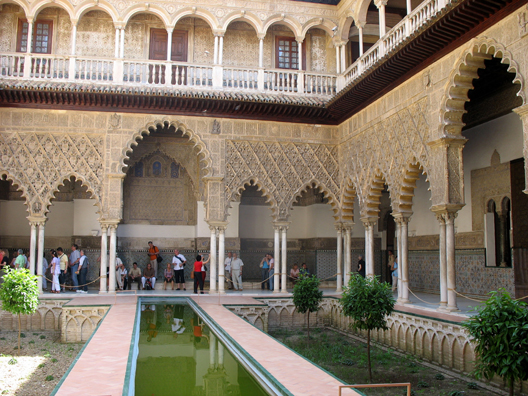 SEVILLA: The heart of the 14th C. Palace of Pedro I is this Mudejar courtyard. Recent excavations had shown that it once hand a pool like this so it has now been reconstructed. The upper balcony was added by Carlos V in classic Renaissance style.