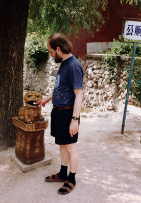 HUAQING TEMPLE: Me demonstrating proper use of a Chinese garbage can.