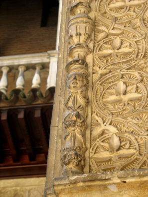 SEVILLA: Note the distinctly non-Muslim head carved in the framing decoration. A devout believer would avoid depicting the human form, especially in a public space such as this.