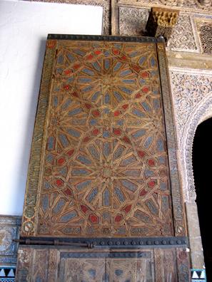 SEVILLA: An ornate wooden inlay door.
