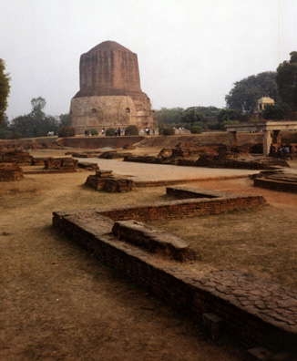 The Dhamekha Stupa at the left is the base of a vast column which was begun but never completed, and which is considered a sacred site by Buddhists.