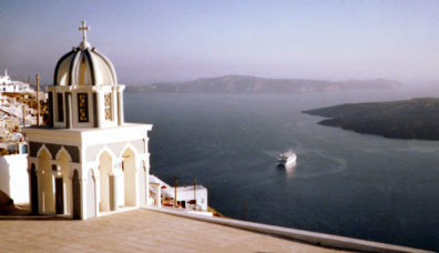 SANTORINI: A big cruise ship, typical of the mainly that sail into the caldera daily. Santorini is definitely a luxury tourist destination; don't try to go there with a backpack looking for a cheap room.