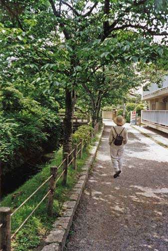 This famous walk parallels a pleasant little canal along a street lined with fine houses and several important Buddhist temples. Tourist Paula Elliot walks along the path. May 26, 1998