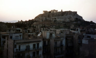 ATHENS: The next day, May 20, we were in Athens, via Olympic Airlines. From the rooftop of our hotel, The Athens Gate, we watched the sun set behind the Acropolis. The hotel was decent, though modest; one of its more attractive features being that it is placed near the Plaka (the traditional shopping district, packed with souvenir shops) and the Acropolis. But the view was spectacular.