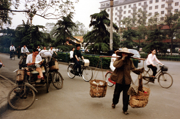CHENG DU: Reading pedicab driver, waiting for a fare.
