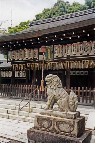 KYOTO: Nice lion. The cord dangling down is used to ring a gong or bell—a feature of many temples. May 26, 1998