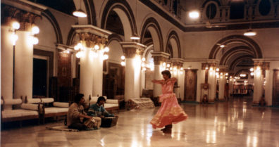 Tabla player, harmonium player, and dancer performing at a Kashmiri Rug emporium in a converted palace.