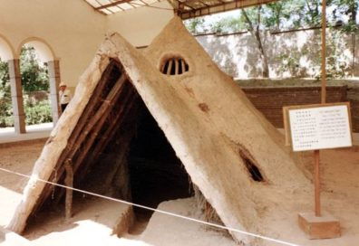 BANPO: Replica of Banpo daub & wattle house. A rope slanted across the opening to keep the curious out.