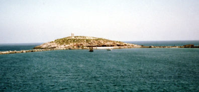 NAXOS: The spit where the ruins of Temple of Apollo, the symbol of Naxos, stands. Here Ariadne, abandoned by Theseus, supposedly leaped into the sea to escape the unwanted attentions of the god.
