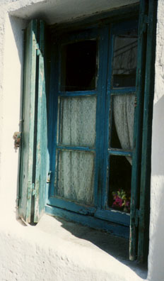 NAXOS: Bright blue paint sits on this window frame in Naxos.