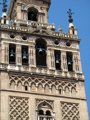 SEVILLA: The Moorish portion of the structure ends just below the bells. Open balconies were bricked up by the Christian architects.