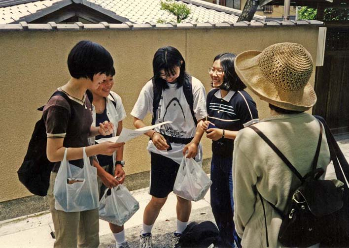 KYOTO: A group of recent junior-high graduates sent out by their teacher to interview foreign tourists in order to practice their English, very common assignment which results typically in very little real communication but illustrates how safe Japanese society is. May 26, 1998