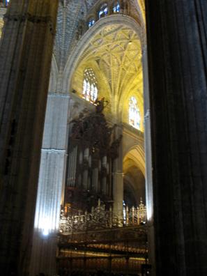 SEVILLA: Soaring Gothic pillars and arches frame the organ.