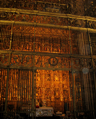 SEVILLA: The elaborate gilded backdrop to the high altar.