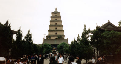 XANXI: Huge pagoda in Xanxi, on the way to the plane for Beijing. We had intended to take another train, but Mr. Cai, disappointed with our first one, got most of the money for the tickets refunded and bought us seats on a modern airplane. Instead we got an old Russian prop-plane that was cramped and noisy; but the attendants kept lavishing us with gifts: cookies, a sandalwood fan, drinks, etc.