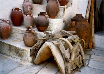 NAXOS: Pots and a donkey saddle.