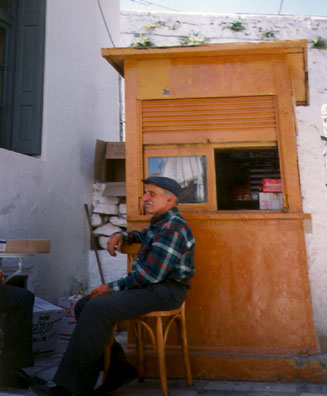 NAXOS: Man at a tiny shop in the square.